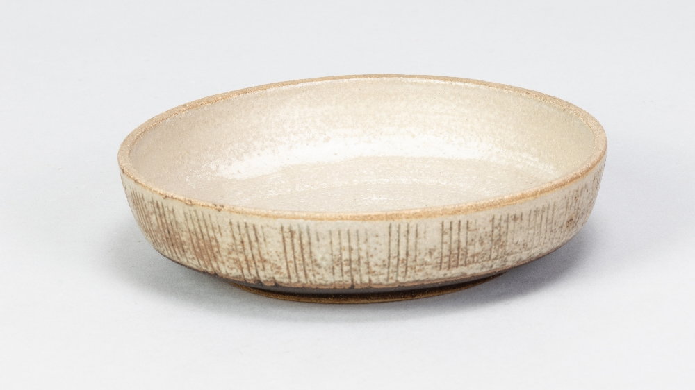 EILEEN LEWENSTEIN (1925-2005); a small stoneware dish with sgraffito decoration, impressed EL