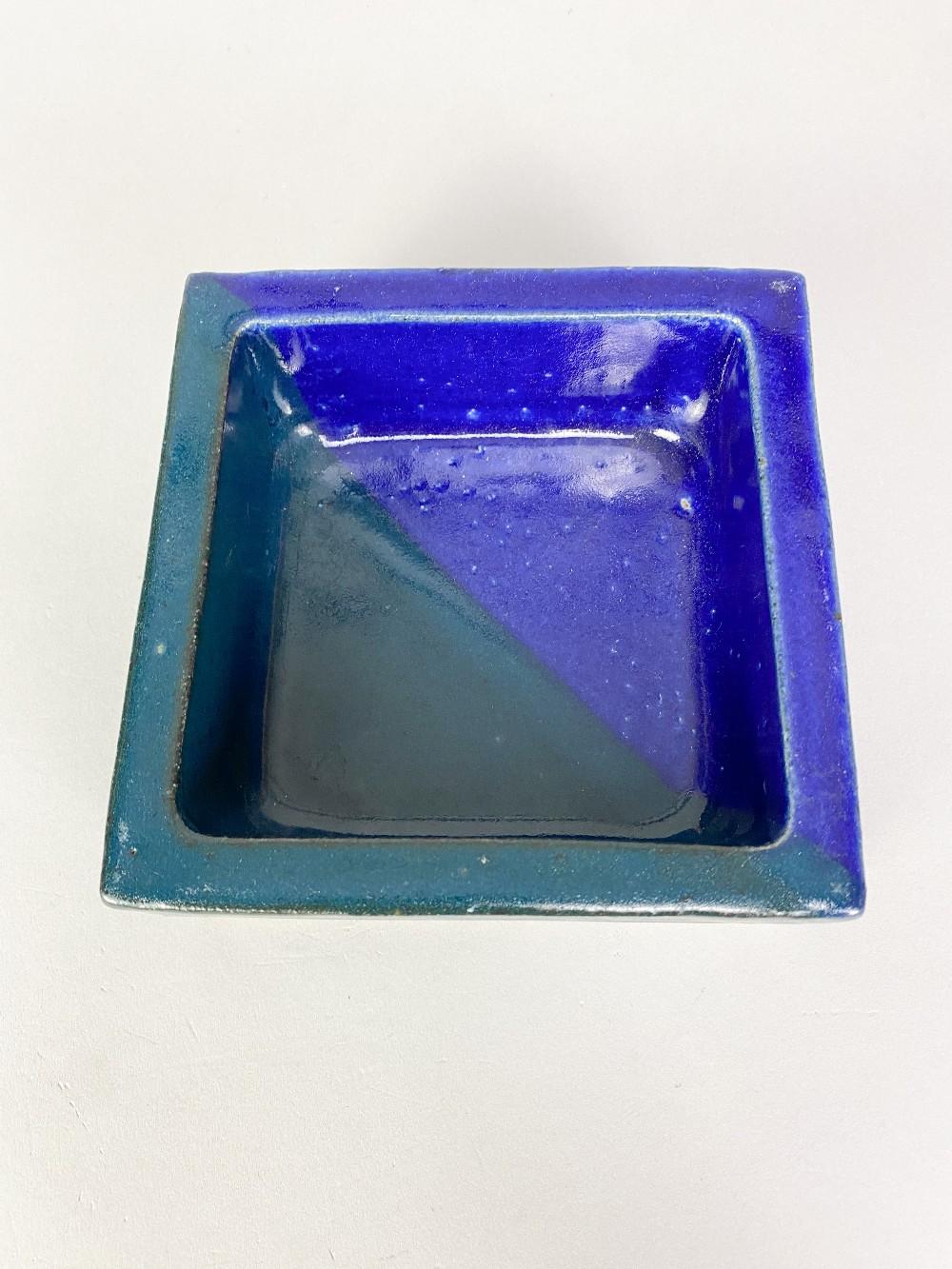 IAN AULD (1926-2000); a square dish covered in dark turquoise and indigo glaze, impressed IA mark, - Image 3 of 5