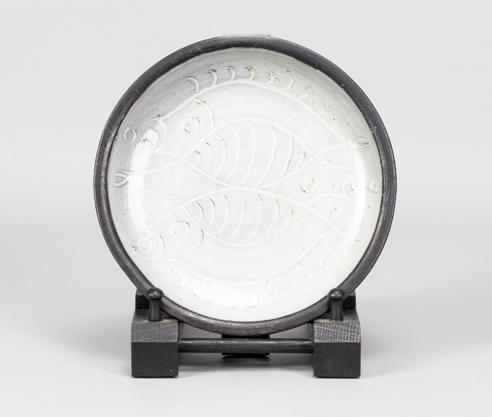 DOROTHY KEMP (1905-2001) for Barnhouse Pottery; a slipware dish with fish decoration on grey ground,