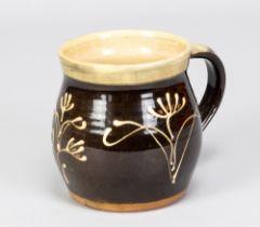 PAUL BARRON (1917-1983); a slipware mug with floral decoration, impressed B mark, made circa 1954,