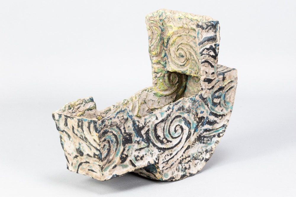 HENRY PIM (born 1947); a stoneware rocking cradle form, textured and incised surface covered in