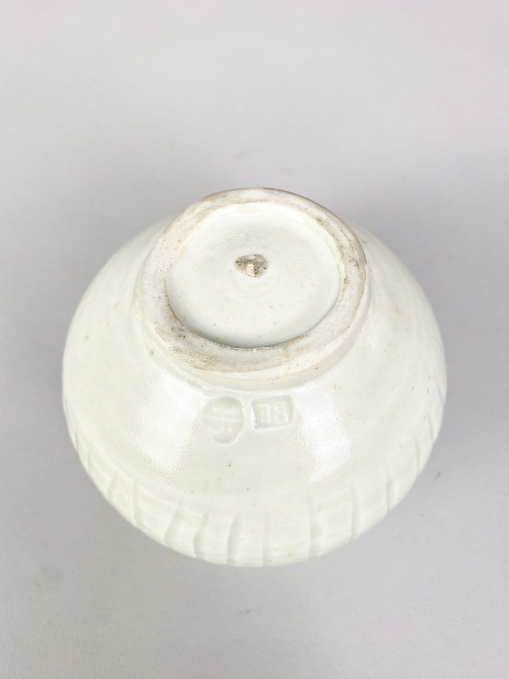 BERNARD LEACH (1887-1979) for Leach Pottery; a fluted porcelain pot covered in celadon glaze, - Image 4 of 5