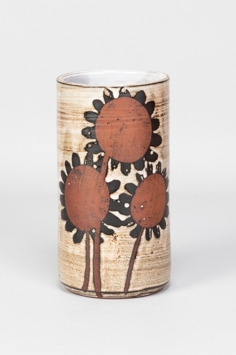 Briglin Pottery; a tall cylindrical tin glazed earthenware vase with sunflower decoration, impressed
