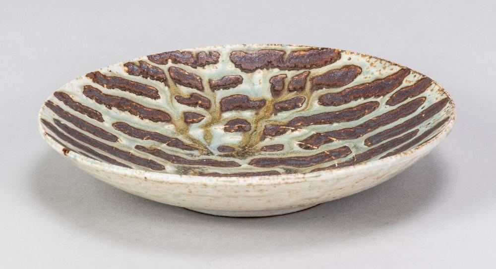DEREK DAVIS (1926-2008); a porcelain dish covered in running green glaze on iron rich ground, - Image 2 of 5