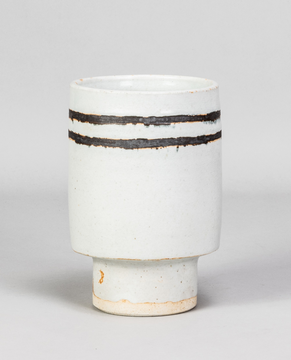 DEREK DAVIS (1926-2008); a cylindrical porcelain footed vase covered in chun glaze with manganese - Image 2 of 5