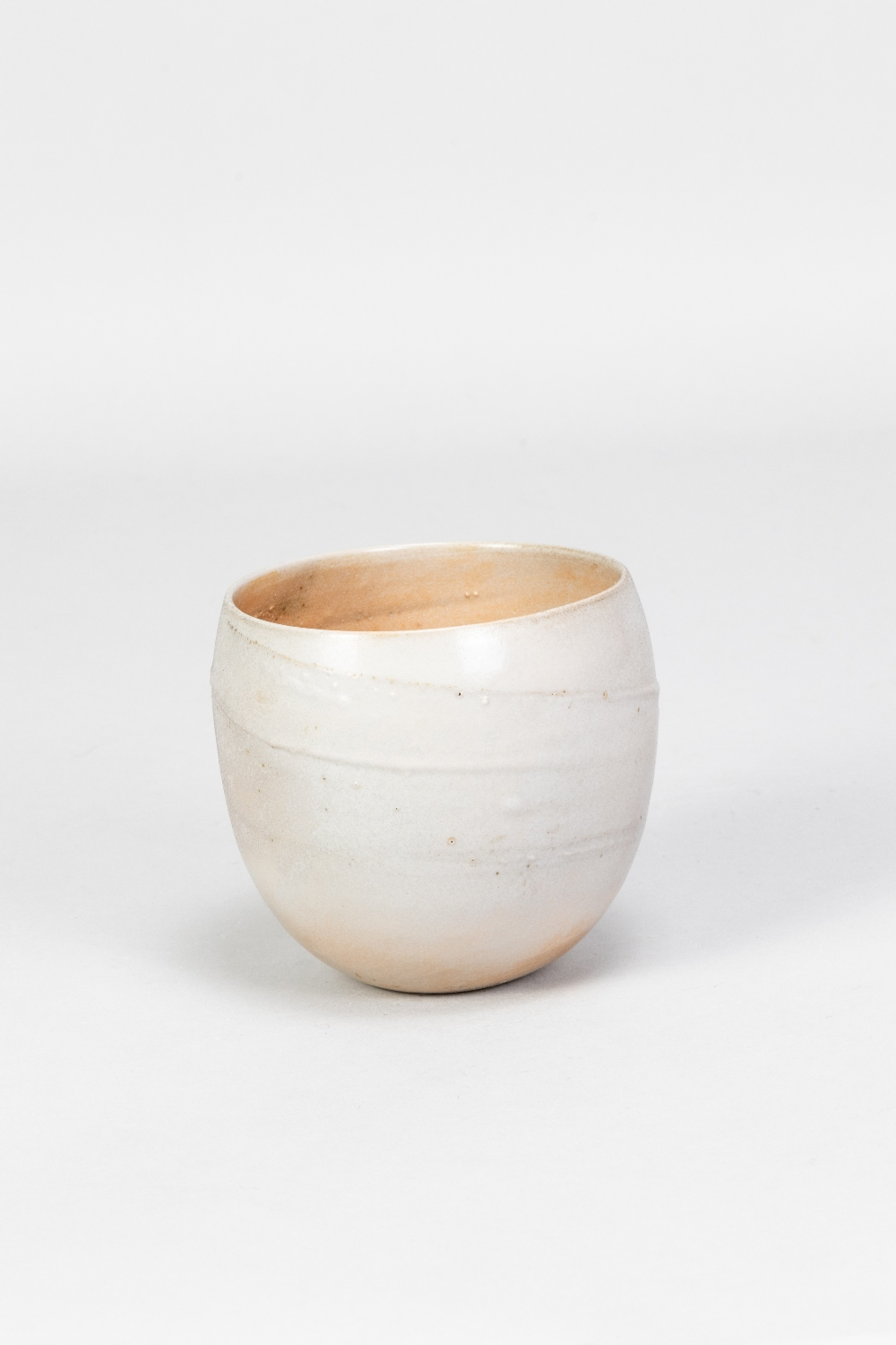 JOANNA CONSTANTINIDIS (1927-2000); a small porcelain vessel, part lustred with incised spiral