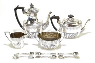 WALKER & HALL; a Victorian and Edward VII hallmarked silver four piece tea set, comprising teapot