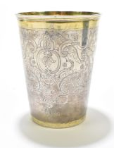 An early 18thcentury Russian parcel-gilt silver beaker of large size, the exterior with a repeating