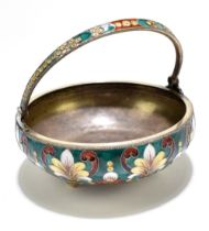A Russian 916 standard silver and enamel basket, with swing handle and decorated with foliate motifs