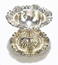 A late 19th century Russian silver pedestal bowl and stand, with cast floral sprays inside