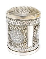 An Eastern white metal cylindrical tea canister and cover, the lift-off lid decorated with an