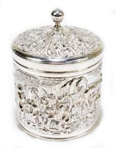 A Dutch silver cylindrical tea canister with knop finial above lid and body decorated with figures
