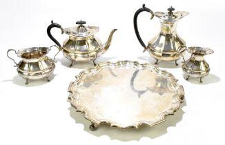 HAMILTON LAIDLAW & CB & CO; a George V hallmarked silver four piece tea set and tray, the tea set