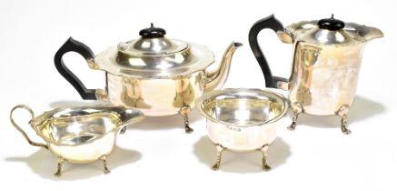 W J MYATT & CO; a George V hallmarked silver four piece tea set, all with shaped rims raised on four