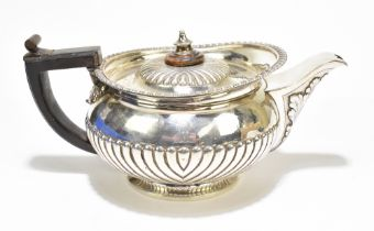 JOHN HAWKINS; a George III silver teapot, with gadrooned rim, acanthus leaf moulded spout and demi-