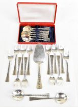 A Russian 916 grade twenty-one piece part service with cast geometric decoration to the handles,