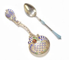 A Russian sterling silver and enamelled teaspoon, the teardrop shaped bowl with blue and white