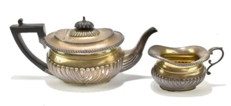 A & J ZIMMERMAN; a Victorian hallmarked silver teapot with ebonised handle and gadrooned detail,
