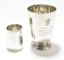 WALKER & HALL; a George V hallmarked silver mug with C-handle, on spreading circular foot, later