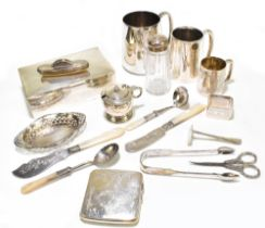 A group of variously hallmarked silver items comprising a cigarette box, two Christening mugs, a