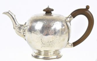LAMBERT & CO; a Victorian hallmarked silver bullet teapot of George I/II design with bright cut