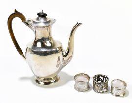 R HODD & SON; an Edward VII hallmarked silver coffee pot of plain oval form, London 1908, together