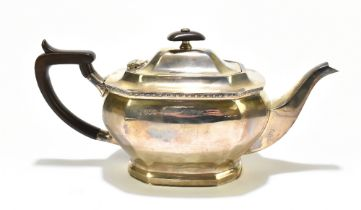 THOMAS BRADBURY & SONS; an Elizabeth II hallmarked silver teapot with Bakelite handle and finial,