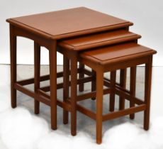 A Stag nest of three teak tables.