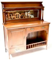 An Edwardian walnut mirror back sideboard, the top with a single shelf supported on columns,