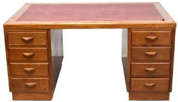 An early 20th century oak eight-drawer twin pedestal desk,