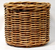 A large round modern wicker log basket, height 54cm, diameter 63cm.