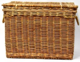 A very large modern wicker basket with heavy rope twist handles,