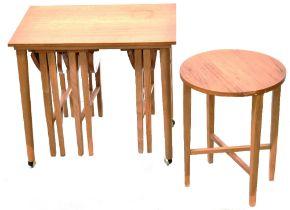 A 1960s retro teak coffee table containing four smaller gateleg drop-leaf tables,