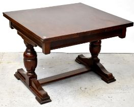 An early 20th century mahogany crossbanded draw-leaf dining table,