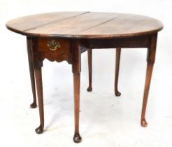 A George II walnut drop-leaf supper table with oval top, with single frieze drawer,