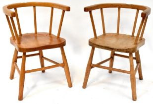 Two children's Windsor-style chairs of matching design, with solid saddle seats, curved back,
