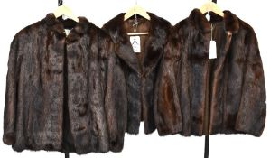 Three vintage c1950s brown mink jackets to include two examples with stand-up collars,