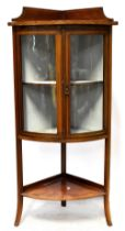 An Edwardian inlaid walnut two-door corner display cabinet,