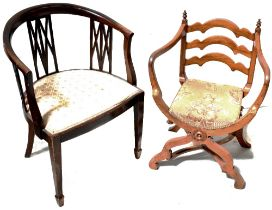 A walnut-framed upholstered Savonarola open arm elbow chair and a further Edwardian tub chair with