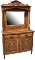 An early 20th century oak Arts and Crafts style dresser,