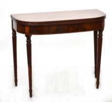 A late 19th/early 20th century mahogany D-end gateleg fold-over tea table to turned tapering legs,