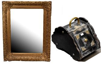 An antique ornate wall mirror with gold painted floral mirror frame,