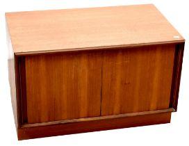 G-Plan; a 1960s retro teak low record cabinet with pair of sliding doors, 49 x 76 x 46cm.