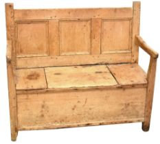 An 18th century rustic pine box seat settle,
