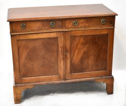 An early 20th century mahogany sideboard with pair of drawers above pair of panelled doors and