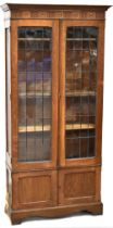 An early 20th century oak bookcase,