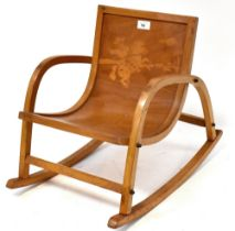 A child's bentwood rocking chair with cowboy design to the seat back, height 43cm.
