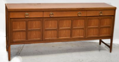 A 1960s retro teak dining suite comprising extending dining table of rounded rectangular form,