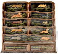 A late 19th/early 20th century Indian inspired waterfall paper rack of four rows of two