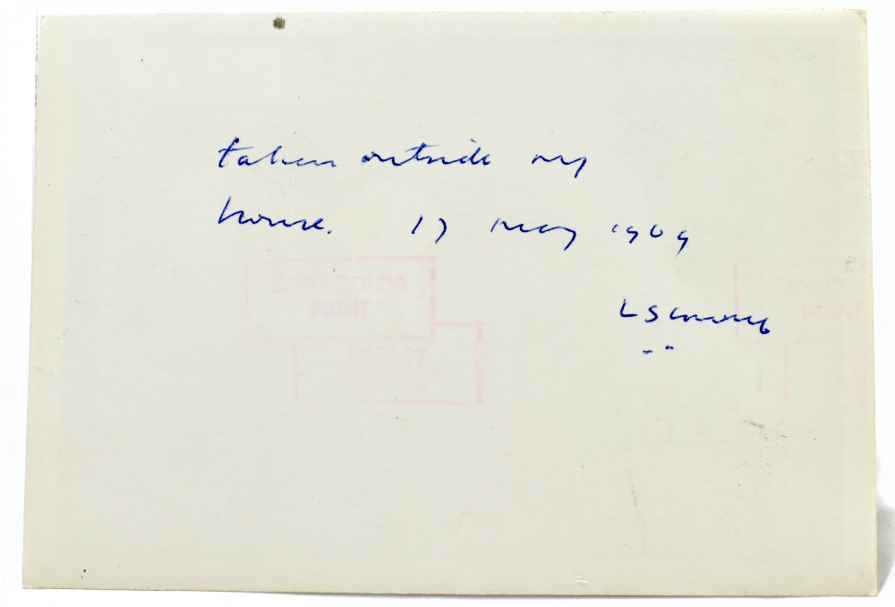LAURENCE STEPHEN LOWRY; inscribed and signed colour photograph of the artist standing outside his - Image 2 of 2